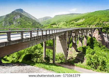 Tara Bridge is a concrete arch bridge over the Tara River in Montenegro - stock photo