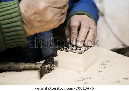 Taracea craftsman - stock photo
