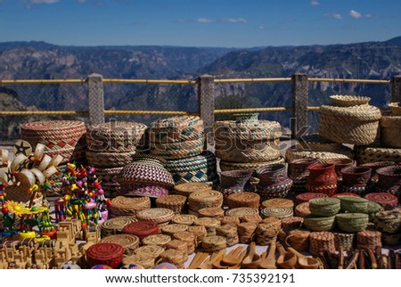 Tarahumara raramuri made souvenirs with the landscapes of the Copper Canyons in the background, Chihuahua, Mexico