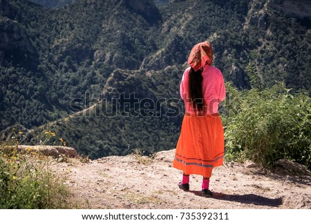Tarahumara woman wearing bright traditional outfit is seen in Copper Canyons, Chihuahua, Mexico