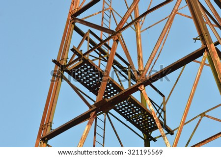 TARAKAN, INDONESIA - SEPTEMBER, 5, 2015 : the maintenance an old oil tower relics of the second world war in Tarakan, Indonesia