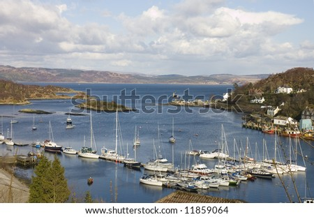 Tarbert, Scotland, harbor, with the Kintyre to Bute ferry arriving in the terminal - stock photo