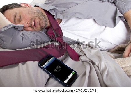tardy employee unable to wake up in time to get to work - stock photo