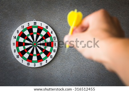 Target aim, symbol of goal and objective over gray grunge background, business concept  - stock photo