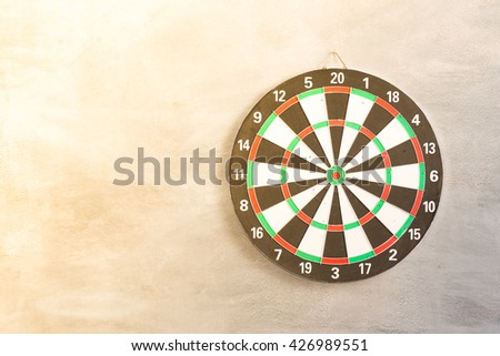 Target aim, symbol of goal  ,The game of darts target on wall - stock photo