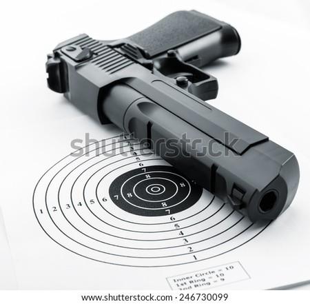 Target and gun - stock photo