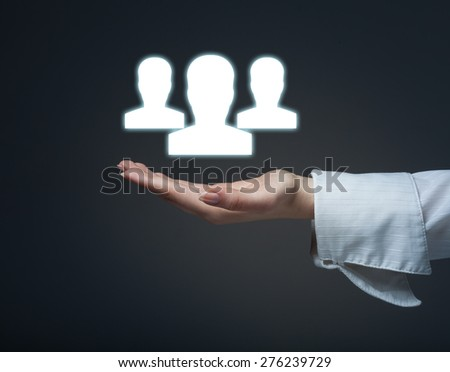 Target audience and customers concept. Woman hold target customer in hand, target audience in background. - stock photo