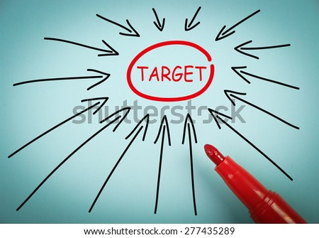 Target concept is on blue paper with a red marker aside. - stock photo