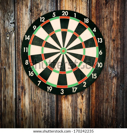 Target for dartboard on the wall of wood - stock photo