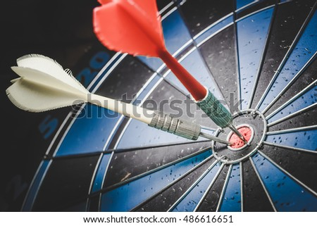 Target marketing or target arrow concept.: Bullseye is a target of business. Dart is an opportunity and Dartboard is the target and goal. So both of that represent a challenge. - Vintage Tone