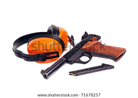 target pistol and hearing protectors - stock photo