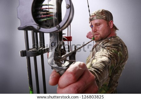 Target practice with a compound bow - stock photo