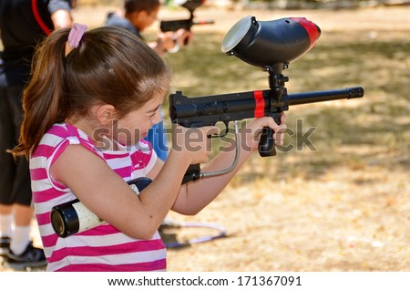Target practice with a paintball gun during the summer holiday - stock photo