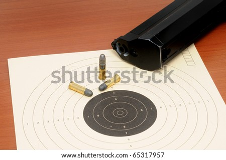 Target shooting with a weapon - stock photo