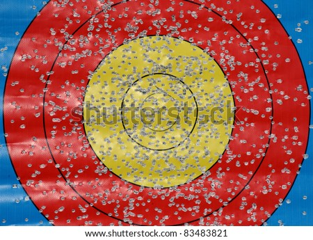 Target with many bullet holes, background - stock photo