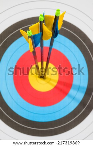 Target with three arrows in the center - stock photo