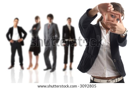 Target - Young attractive business people - the elite business team - businesswoman with goal in focus - stock photo