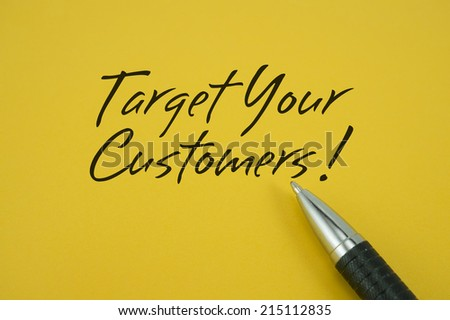 Target Your Customers! note with pen on yellow background