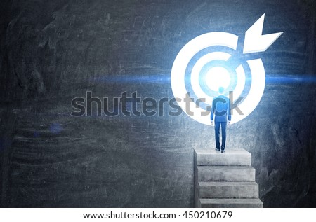 Targeting concept with businessman on top of concrete ladder leading to abstract illuminated dartboard sketch on chalkboard background - stock photo