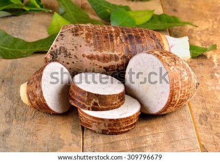 Taro root on wooden background - stock photo