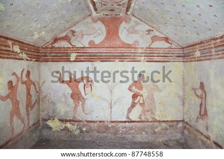 Tarquinia, Italy, around 470 B.C. Via a narrow corridor leading downstair one has access to the rectangular burial room with a sloping ceiling - stock photo