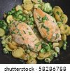 Tarragon chicken cooking in wok. - stock photo
