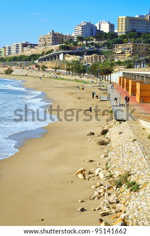 TARRAGONA, SPAIN - NOVEMBER 23: Miracle Beach and panoramic view of the city on November 23, 2011 in Tarragona, Spain. This beach, the closest to downtown, is 980 meters long and 52 meters wide