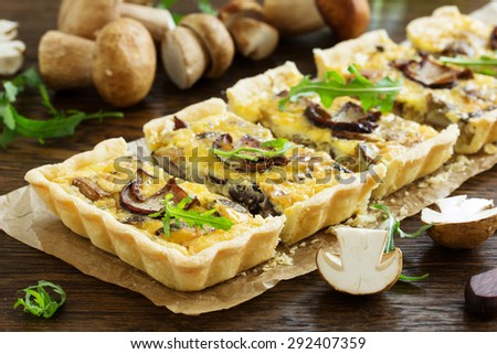 Tart (Cake) with wild mushrooms. Selective focus. - stock photo