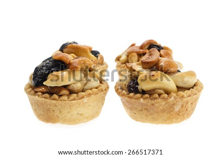 Tart cashew and raisin isolated on a white background. - stock photo
