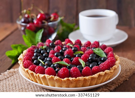 Tart with berries and custard - stock photo