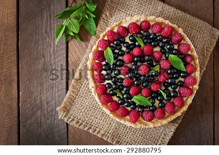 Tart with berries and custard. Top view - stock photo