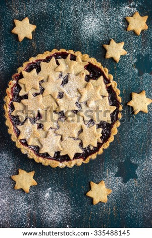 tart with berry jam and cookies, top view - stock photo