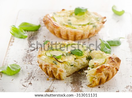 Tart with cheese on a wooden background. Selective focus - stock photo
