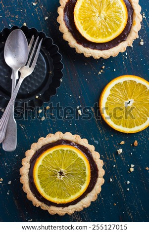 Tart with chocolate and orange, top view - stock photo