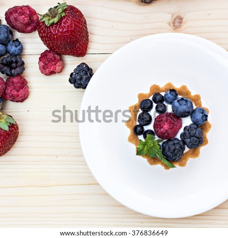 Tart  with Fresh berries - dessert on wooden table close up - stock photo