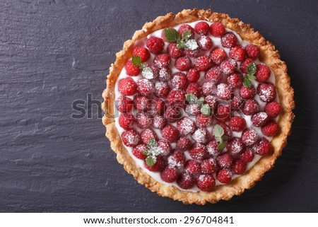 Tart with fresh raspberries and mint on a table. horizontal view from above  - stock photo