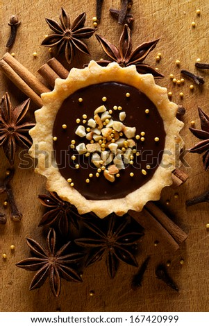 Tart with milk chocolate  and cashew nuts - stock photo
