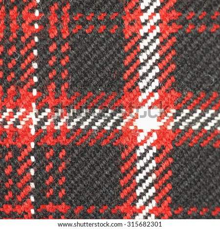 Tartan fabric texture useful as a background - stock photo