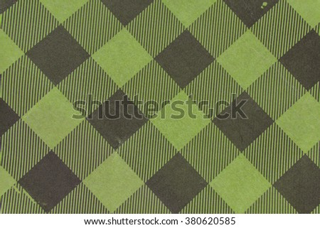Tartan old plaid fabric pattern in green background - stock photo