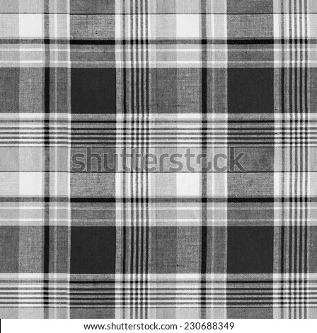 Tartan plaid black and white natural cotton fabric. Seamless tiles texture for the background - stock photo
