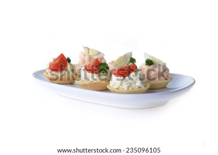 tartlet with cream and dill on dish