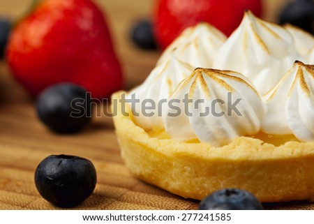 Tartlet with lemon curd  and meringue horizontal close-up - stock photo