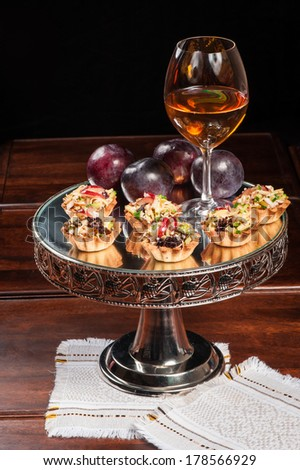 Tartlets with chicken, olives, cheese and other ingredients - stock photo
