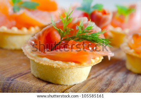 Tartlets with red caviar and salmon