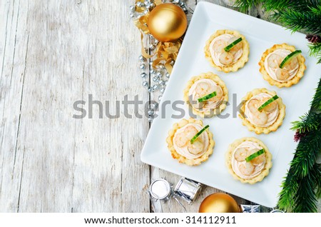 tartlets with salmon mousse, shrimp and cucumber for the New year. the toning. selective focus - stock photo