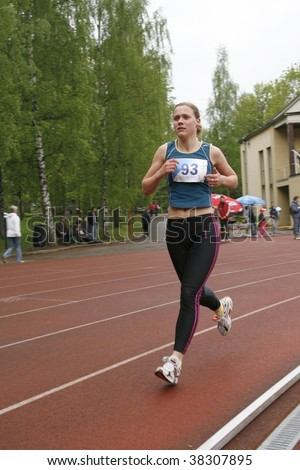 TARTU, ESTONIA - MAY 20: Athlete running along the track and taking part in Student Sell Games, organized by Estonian Academic Sports Federation in May 20, 2006 - stock photo