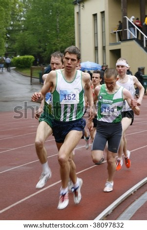 TARTU, ESTONIA - MAY 20: Athletes running along the track and taking part in Student Sell Games, organized by Estonian Academic Sports Federation on May 20, 2006 in Tartu, Estonia. - stock photo