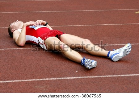 TARTU, ESTONIA - MAY 20: Tired sportsman after a race in Student Sell Games organized by Estonian Academic Sports Federation on May 20, 2006 in Tartu, Estonia. - stock photo