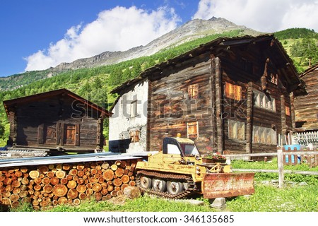 TASCH, SWITZERLAND - JUNE 17, 2015: The ancient traditional chalet along Dorf. Tasch is one of the quaint and picturesque village in the country.                     - stock photo