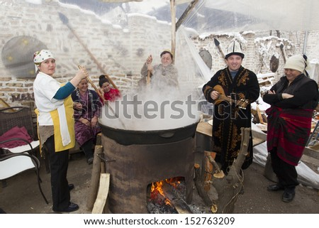 TASHKENT, UZBEKISTAN - MARCH 20: Unidentified people cooking palov (meat dish) at a street  of Tashkent on March 20, 2012.  The traditional cooking is a tourist attraction in the capital city.